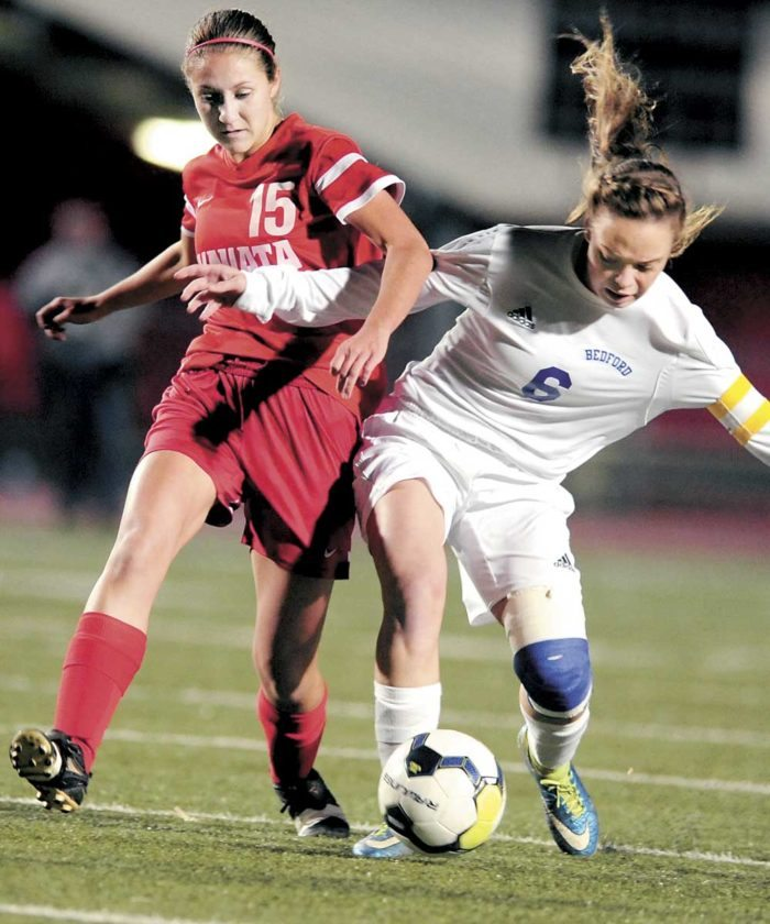 Sentinel photo by GARY BARANEC Juniata's Brenna Strawser, left, and Bedord's Amelia Beland fight for the ball Thursday at Altoona's Mansion Park.