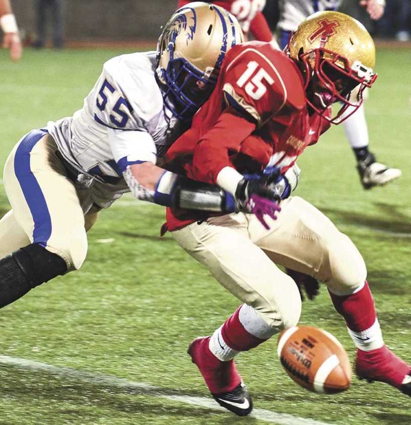 Sentinel photo by TAMI KNOPSNYDER Mount Union's Pat Walker forces Bishop McCort's Imil Britt to fumble in the first half of Saturday's District 6 Class AA quarterfinal at Point Stadium in Johnstown.