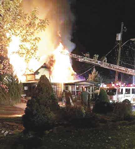 Photo courtesy of Josh Pannepacker Flames shoot out of the Waterfront Tavern early Saturday morning.