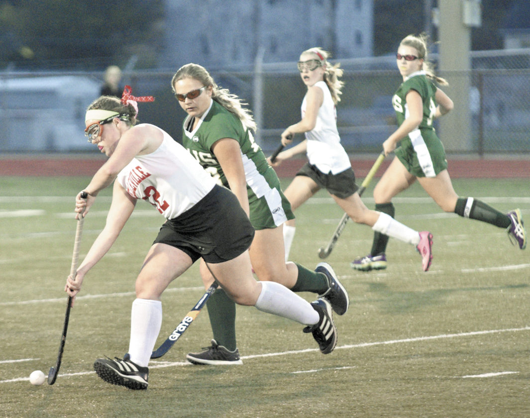 Sentinel photo by JEFF FISHBEIN Belleville Mennonite's Leah Echard moves the ball ahead of Ellis School's Emma Bisello in their PIAA Class A first-round field hockey game at Bald Eagle Area Tuesday. Trailing the play are the Thunder's Elizabeth Miller and Ellis' Abigail Stubenhofer.
