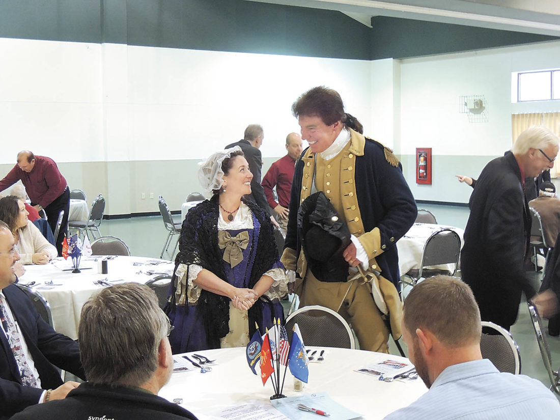Sentinel photo by KIERNAN M. SCHALK Professional re-enactors Sam Davis, right, and Alisa Dupuy came as Gen. George Washington and his wife, Martha, during Friday's Rotary Club of Lewistown Veterans Day banquet.
