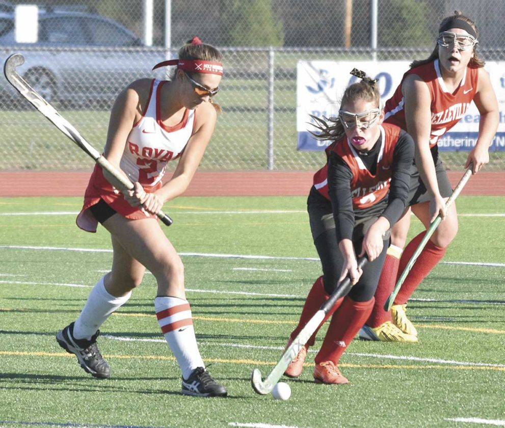Sentinel photo by JEFF FISHBEIN Belleville Mennonite's Sarah Farley, center, moves the ball away from Emily Easton of Holy Redeemer during their PIAA Class A quarterfinal game Saturday at Central Columbia. Thunder's Melissa Yoder backs up the play.