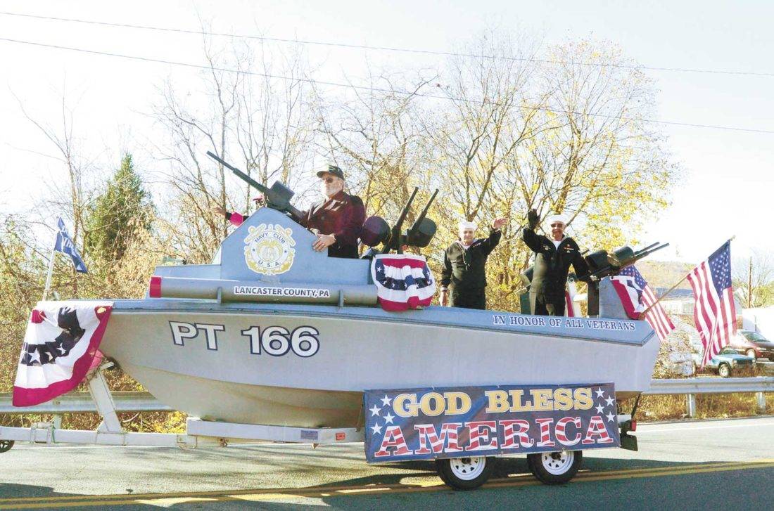 """The Lancaster, PA Navy Club of the United States of America, """"Chartered by Congress 1940"""" of the Coast Guard, Marines, and Navy ship PT 166 came out for the Veterans Day Parade. From left, Jim Pearson, Don Christ, and Walter King.   Sentinel photo by TIM  SHUMAKER"""