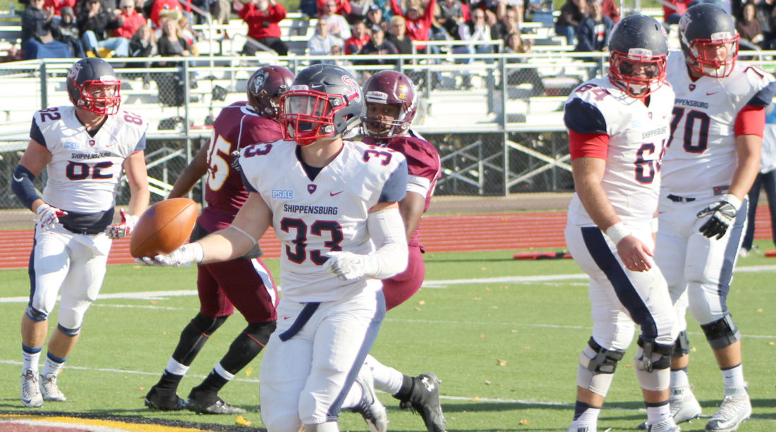 Sentinel photo by WILLIAM WHISLER Shippensburg University's Cole Chiappialle scores a touchdown against Bloomsburg this year. Chiappialle started his career at Penn State but transferred to the PSAC school, where he has found success on the field.