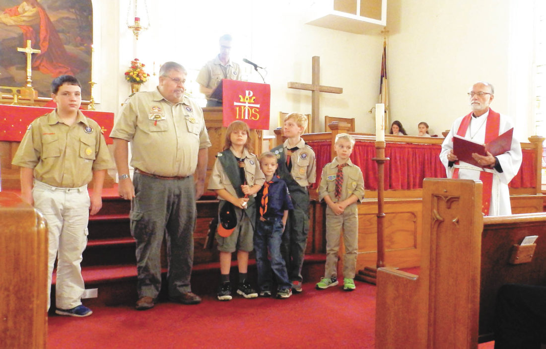 Photo submitted by JESSICA FOLTZ Tim Foltz is presented the Lamb Award for distinguished service to Boy Scout Troop 124 during the Oct. 30 church service at Port Royal Lutheran Church. Foltz is joined by members of the troop and was presented the award by Dan Smith, top, and Pastor Charlie Hershberger.