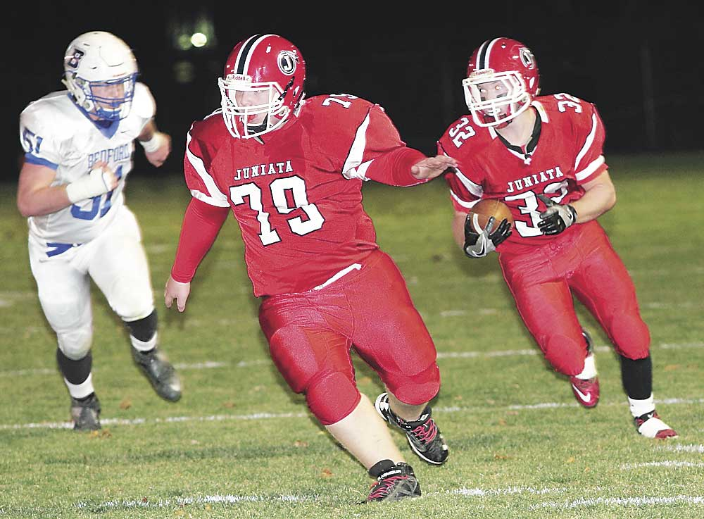 Sentinel file photo Juniata running back Spencer Page (32) follows lineman Ryan Reynolds (79) along the sideline Nov. 12 in Mifflintown.