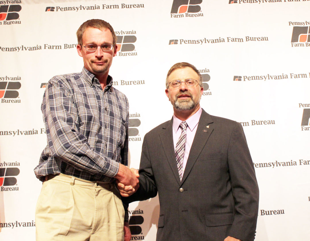 Photo submitted by JACKIE MATTER Juniata County Farm Bureau President Matt Matter, left, shakes the hand of Pennsylvania Farm Bureau President Rick Ebert after  accepting an award on behalf of the county.