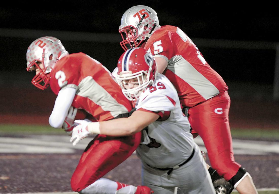 Sentinel photo by GARY BARANEC Juniata defensive tackle Joshua Parson (59) wraps up Central's quarterback Alex Hoenstine (2) during the District 6 Class 3A championship game Saturday, in Altoona.
