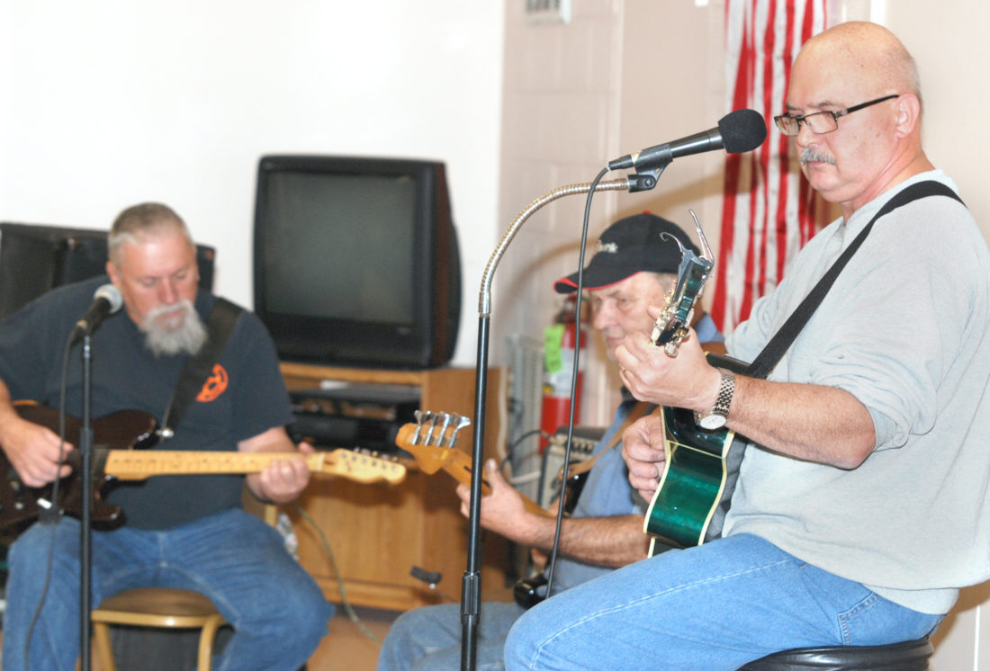 Sentinel photo by BRADLEY KREITZER Members of the band Country Roots perform Tuesday evening, at the Yeagertown Senior Center.