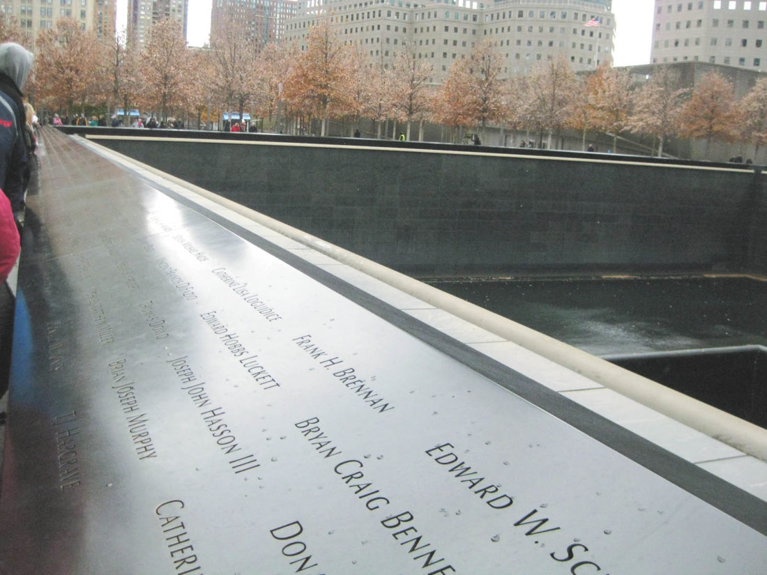 Sentinel photo by BRADLEY KREITZER Names of victims are etched in bronze panels surrounding the North reflecting pool at the memorial.