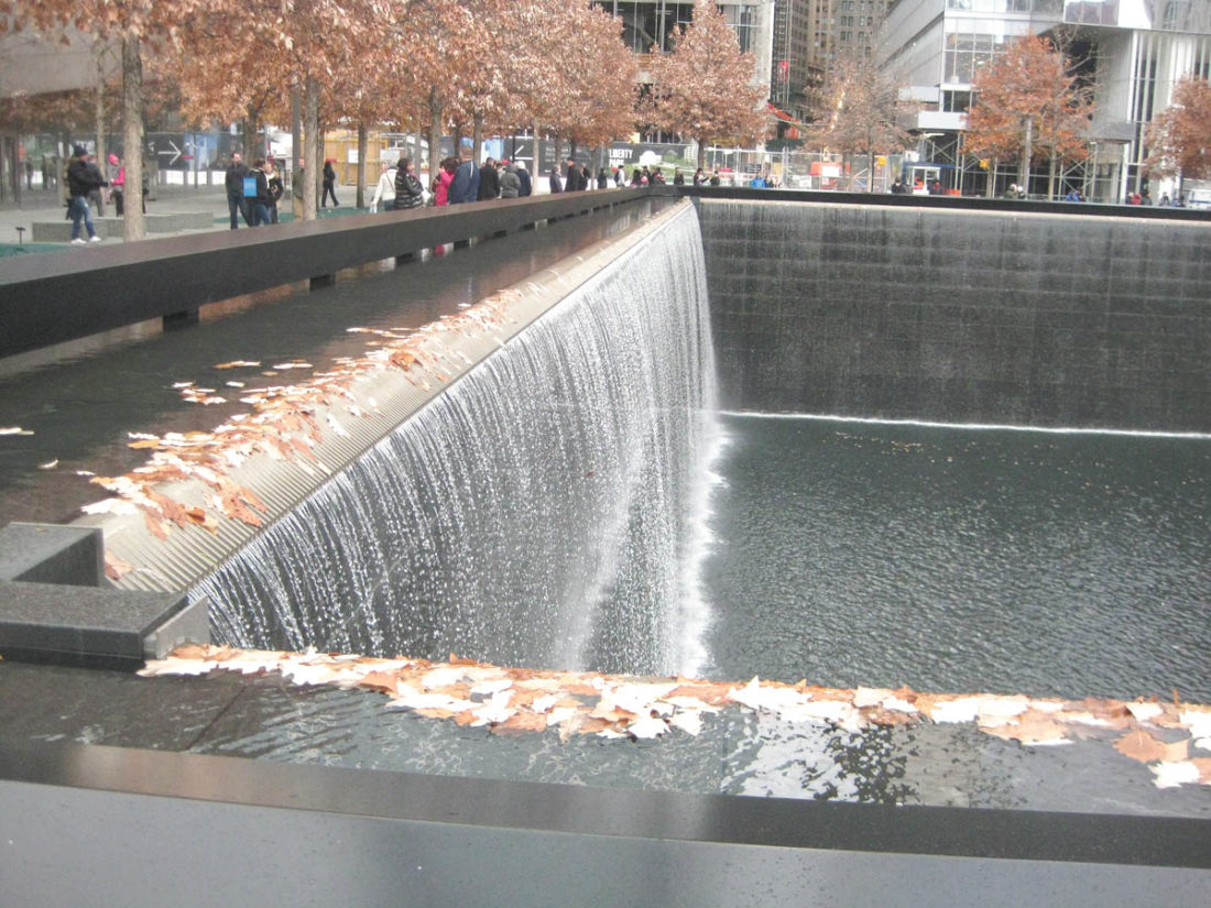 Sentinel photo by BRADLEY KREITZER A portion of the waterfall, above, can be seen at the South reflecting pool of the September 11 Memorial in Manhattan.
