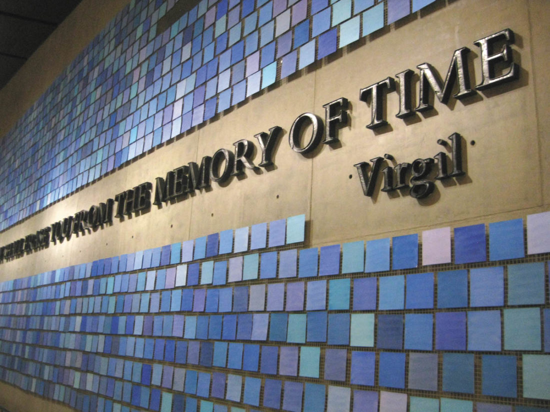 Sentinel photo by BRADLEY KREITZER An art installation composed of 2,983 individual watercolors 'Trying To Remember the Color of the Sky on That September Morning,' by artist Spencer Finchis surrounds a quote by the poet Virgil on the wall of a repository for the remains of 9/11 victims at the 9/11 Memorial Museum in downtown Manhattan, New York City.