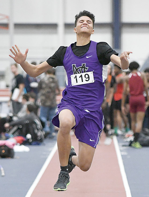 Sentinel photo by JEFF FISHBEIN  Mifflin County's Jordan Fisher leaps for the long jump event at the State College indoor track and field meet on Thursday, in University Park.
