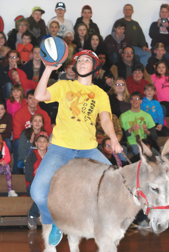 Sentinel photo by BRADLEY KREITZER  Grace Brosious takes a shot during the annual Donkey Basketball game Thursday evening at the Tuscarora Junior High School in Mifflintown.