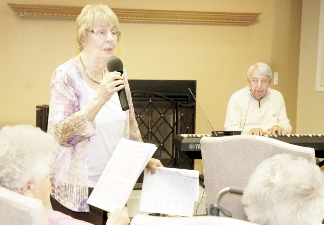 Sentinel photo by Buffie Boyer Skip Leeper plays piano at Elmcroft Senior Living, while Carol Bower sings in January.