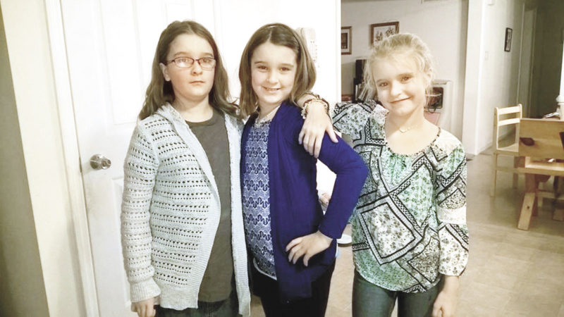 """Photo by Tabitha Goodling A recent photo of the Goodling triplets posing in new clothing from a shopping trip: Lily dressed in a """"comfy"""" sweater; Hope in her signature blue, and Melinda showing off the bling of accessories (bracelet, necklace) and her new blouse."""
