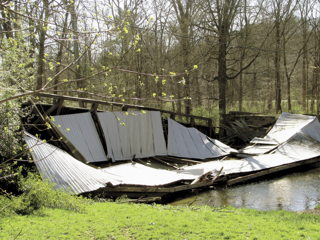 Sentinel photo by TABITHA GOODLING  The historic Dimmsville Bridge located just off Cocolamus Creek Road near Millerstown collapsed last week.