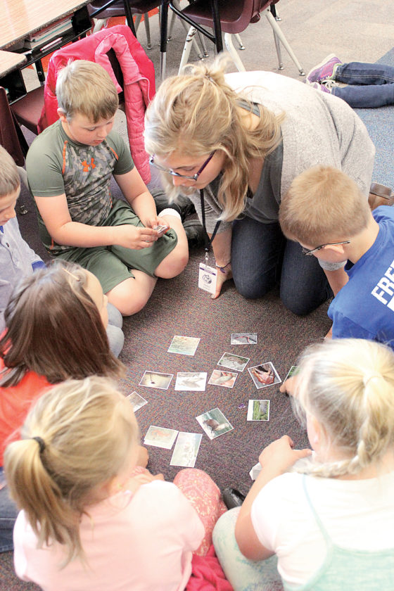 Sentinel photo by JULIANNE CAHILL  Addie Snyder, Penn State student, teaches second graders about animals and their habitats during a presentation Wednesday afternoon at Indian Valley  Elementary School. Snyder, along with eight other college students, visited IVES on behalf of Students Engaging in Experiential Discovery, a class that studies at Shaver's Creek Environmental Center. SEED students will be back at IVES tomorrow to talk more about wildlife and also participate in Outdoor School, attended annually by Mifflin County School District fifth graders.