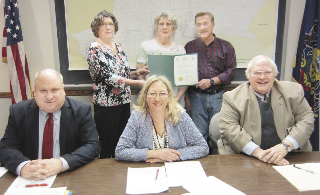 Sentinel photo by JOE CANNON  The Mifflin County Commissioners on Thursday adopted a proclamation designating May as 'Older Americans Month.' Participating in the proclamation ceremony were, seated from left, Commissioners Kevin Kodish, Lisa Nancollas and Stephen Dunkle. Standing, from left, Mary Ann Demi, executive director of Mifflin-Juniata Regional Services Corporation; and Linda Himes and John Kauffman, of the Milroy Senior Citizen Center. Nancollas resigned as commissioner during the Thursday meeting.