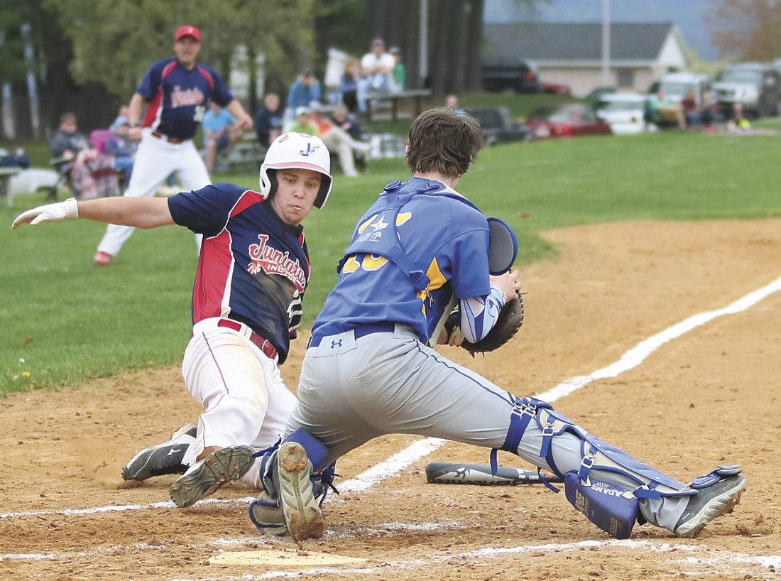 Sentinel photo by MATT STRICKER  Juniata's Donovan Ranck, left, looks to get his foot on home plate as Greenwood catcher Bryce Dalpiaz  turns to apply the tag Thursday in Mifflintown.