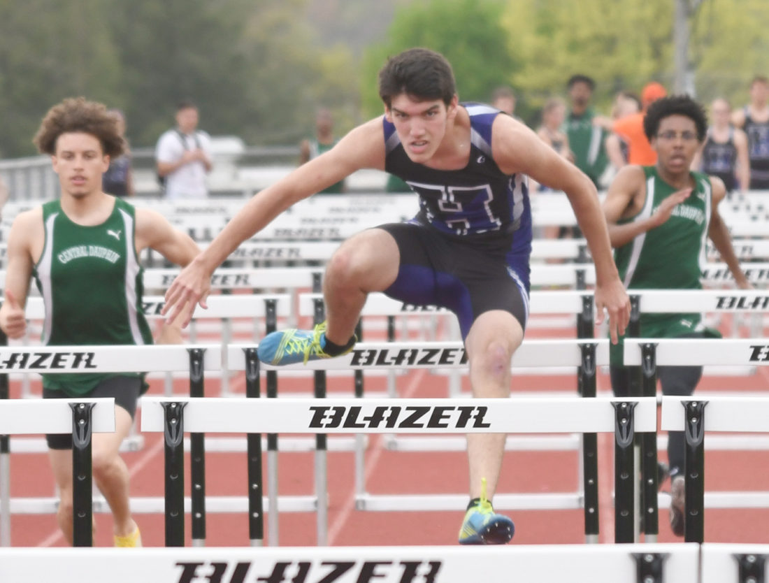 Sentinel photo by JEFF FISHBEIN The Huskies' Michael Tate leads in the boys 110-meter hurdles against Central Dauphin Thursday in Lewistown.