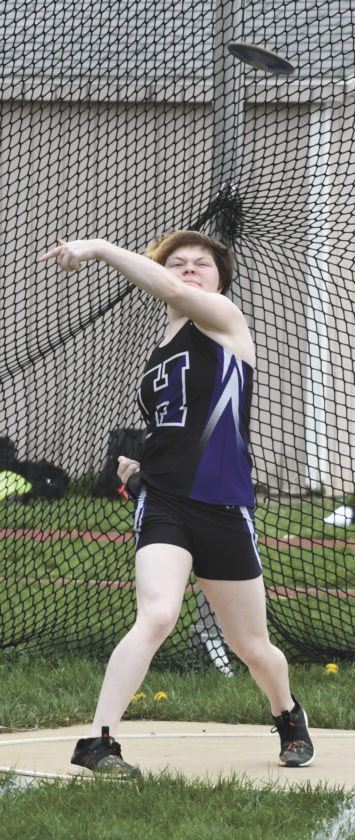 Sentinel photo by JEFF FISHBEIN Layla Shimp releases the discus in the Mifflin County girls meet against Central Dauphin. Shimp had a better throw in the shot put, which she won with a personal best effort.