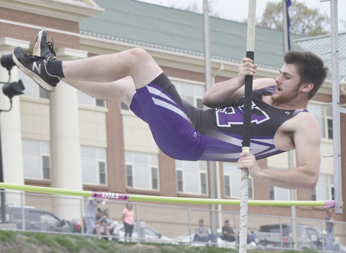 Sentinel photo by JEFF FISHBEIN Mifflin County's Scout Kyler clears the bar in the boys pole vault against Central Dauphin Thursday in Lewistown. Kyper helped the Huskies to a sweep of the event.