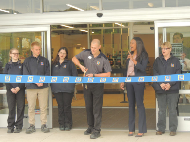 Sentinel photo by KIERNAN M. SCHALK ALDI celebrated its grand reopening Friday in Burnham. Participating in the ribbon cutting ceremony were, from left to right, Miranda Varner, Jordan Wise, Amanda Sheaffer, Andrew Sheaffer, Deanna Hall and Jeanette Rowles. The store was recently remodeled.