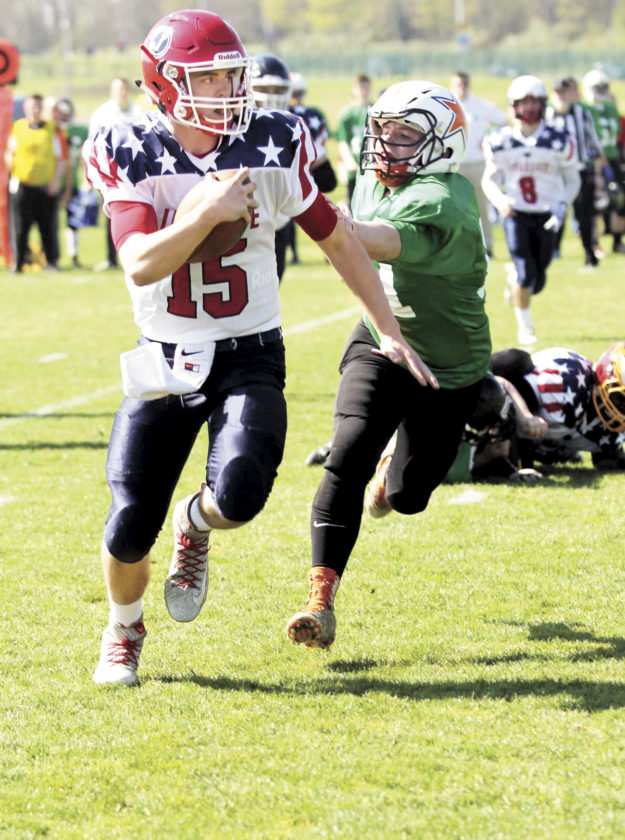 Photo courtesy of CATHY MORRISON Tyler Clark, left, from Juniata High School, plays in the American Football Worldwide game in Dublin, Ireland in April. Clark represented the United States on the Elite team in the first game ever between high school age players from the two countries.