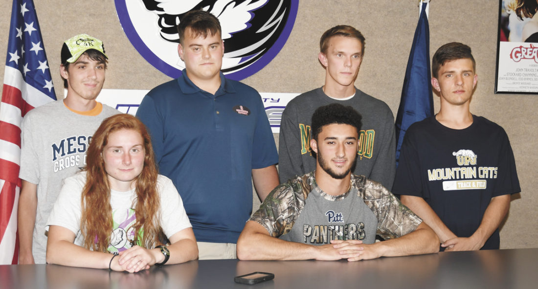 Sentinel photo by JEFF FISHBEIN  Mifflin County track and field athletes who plan to continue in college include, from left, front, Emily Bielski and Malik Sechler; back, Benjamin Falkner, Andrew Bennett, Andrew Montgomery and Hunter Sheaffer.