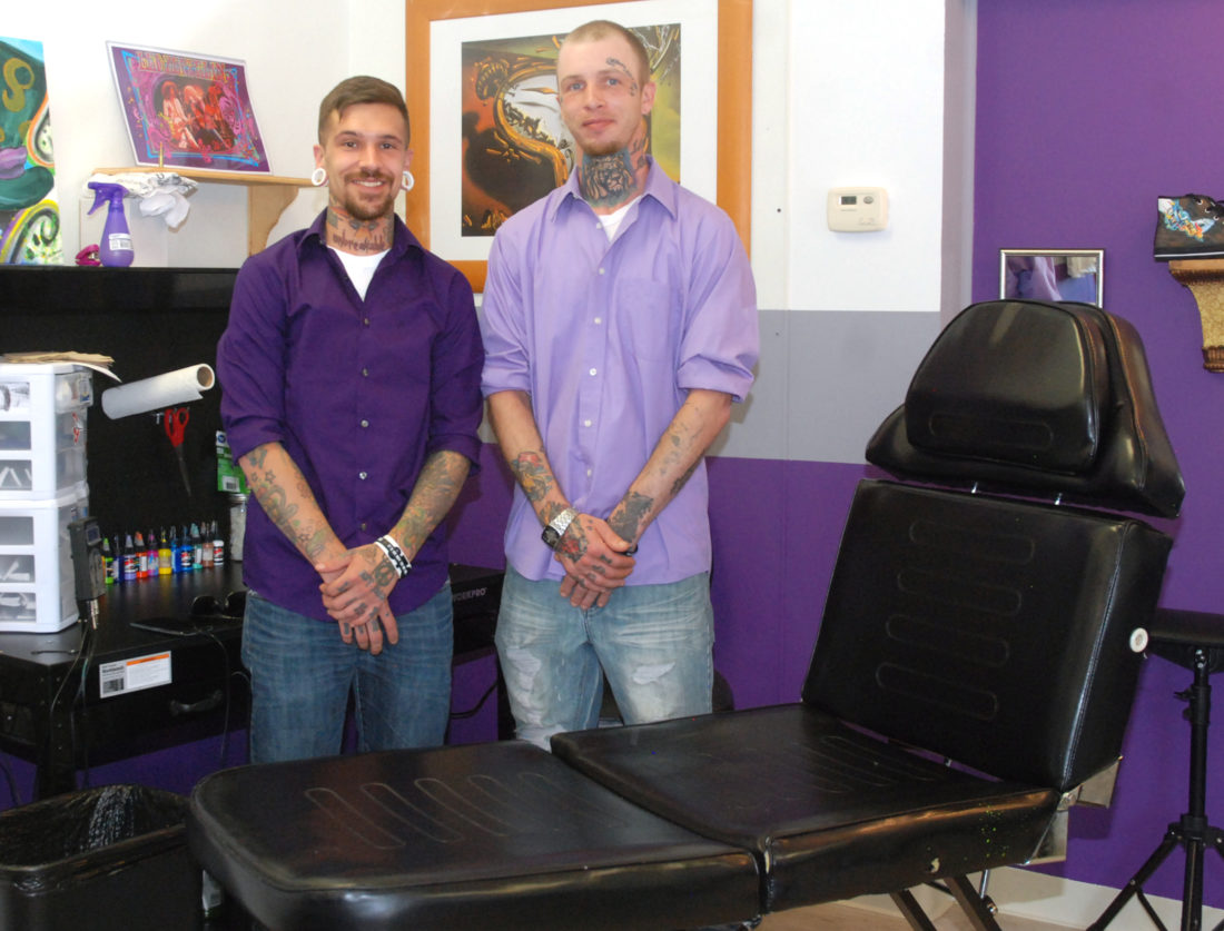 Sentinel photo by BUFFIE BOYER  Cody Seager, left, and Paul Tower, offer piercing and tattoo services at the new Ink is Art parlor in Burnham.