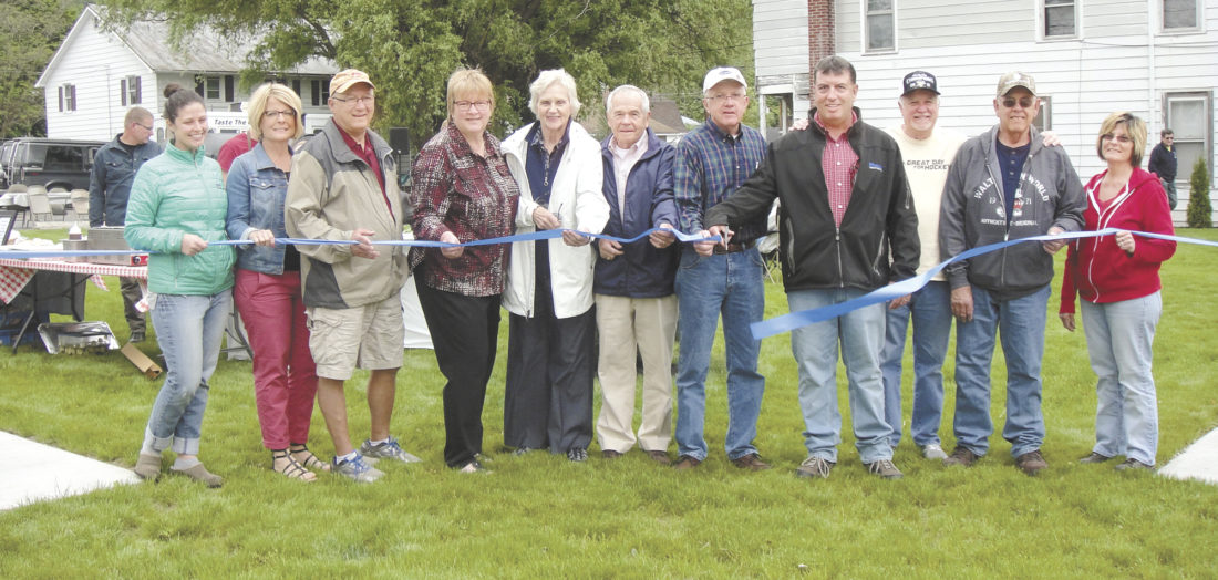 Photo submitted by KAYSEMLER   A ribbon was cut by beautification committee members, township supervisors and other project contributors to seal the dedication of Brown's Mills Square. Shown are, from left, Liz Hoffner, Jill Metzler, Scott Bubb, JoAnn Smith, Betty Mitchel, Mark Glick, Scott Pecht, Jamie Fultz, Frank Zook, Roy Fultz and Marvina Kratzer.