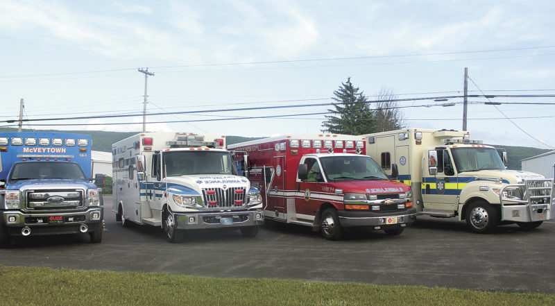 Sentinel photo by LAUREN KERSHNER  Ambulances from McVeytown, Big Valley, Milroy and Fame EMS are parked in a row in Belleville. All four  companies came together to talk about the emergency medical services in Mifflin County.