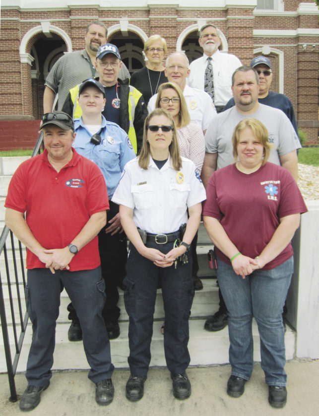 "Sentinel photo by JOE CANNON  The Juniata County Commissioners on Tuesday adopted a proclamation designating May 21 – 27 as ""Emergency Medical Services Week."" Participating in the proclamation ceremony were, front row, from left, John Horan, Central Juniata EMS; Laura Shay, Port Royal EMS; and Dawn Hart, Fayette Township EMS. Second row, from left, Marissa McKnight, Central Juniata EMS; Jess Rice, Lack-Tuscarora EMS; and Glenn Kerstetter, Fayette Township EMS. Third row, from left, Joe Weirich, Lack-Tuscarora EMS; Dale Gingrich, Richfield EMS; and Mike Graybill, Richfield EMS. Top row, from left, Commissioners Todd Graybill, Alice Gray and Mark Partner."