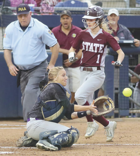 Sentinel photos by MATTSTRICKER  State College's Kayla Hawbaker(1) beats a throw to Mifflin County catcher Caitlyn Smith in the District 6 Class 6A softball championship game Wednesday at Penn State.