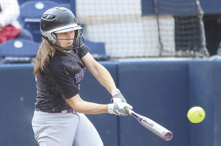 Sentinel photos by MATTSTRICKER  Mifflin County's Darcy Wilson puts a ball in play.