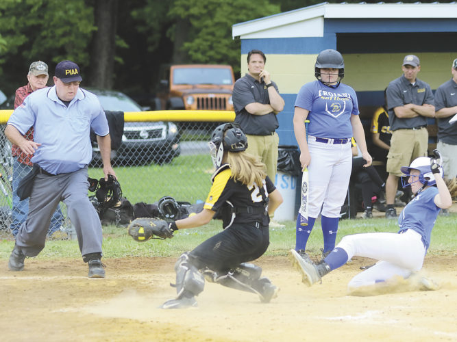 Sentinel photo by MATTSTRICKER  Mount Union's Madison Harris slides safe into home as Northern Cambria catcher Ashley Parrish fields the ball Thursday in Mount Union.  Watching the play is Mount Union's McKenzie Boozel. Mount Union won the gam, 10-0.