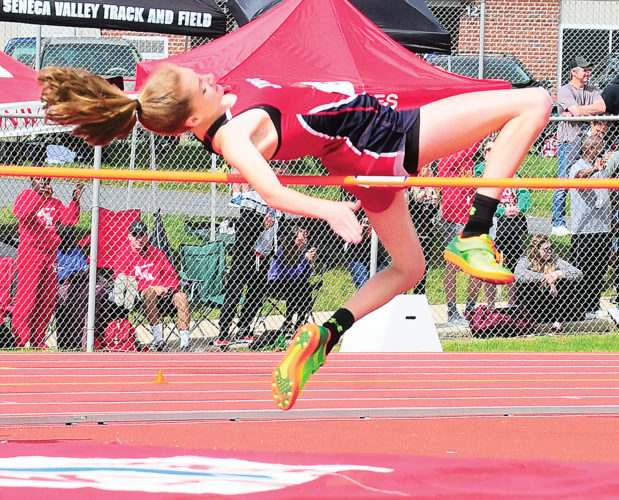 Sentinel photo by TIM SHUMAKER  Juniata's Sydney Sheaffer clears the bar in the high jump at the PIAA Class 2A track and field championships Friday in Shippensburg.