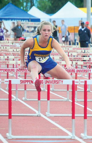 Sentinel photo by TIM SHUMAKER  Greenwood's Paityn Wirth races in a Class 2A girls 100-meter hurdles race Friday at the state track and field championships.