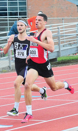 Sentinel photo by TIM SHUMAKER  Mifflin County's Seth Phillips, left, runs in the Class 3A 800-meter run Friday at the PIAA track and field championships.