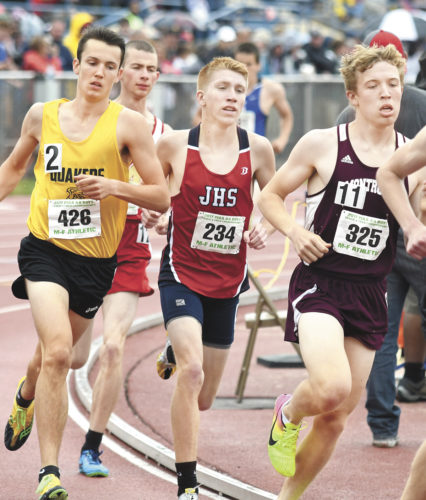 Sentinel photo by JEFF FISHBEIN  Juniata's Garrett Baublitz runs the 1,600-meter in the Class 2A state meet Saturday at Shippensburg Univeristy.