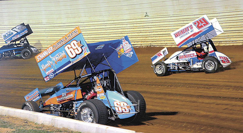 Sentinel photo by TIM SHUMAKER  Lance Dewease, 69k, and Danny Dietrich, 29, race hard off turn two in Port Royal Speedway's Bob Weikert Memorial Weekend Fallen Heroes Sprint Car Championship. Dewease won the feature.