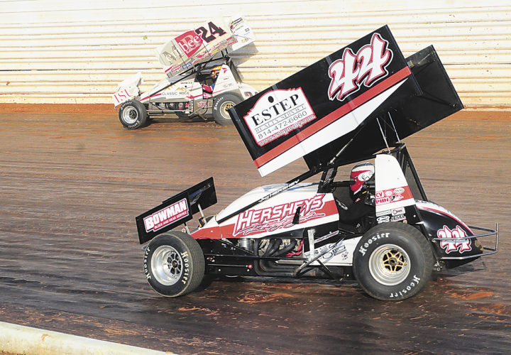 Sentinel photo by TIMSHUMAKER  Lucas Wolfe, 24, keeps his lead over Trey Starks, 44, in the Bob Weikert Memorial sprint car feature at Port Royal Speedway, Monday, in Port Royal.