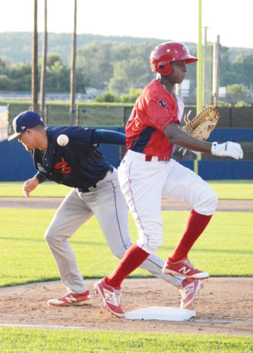 Sentinel photo by KATELYNHIBBARD  State College Spikes' first baseman Tyler Lancaster loses the ball and his glove as Williamsport Crosscutters' Malvin Matos crosses first base.