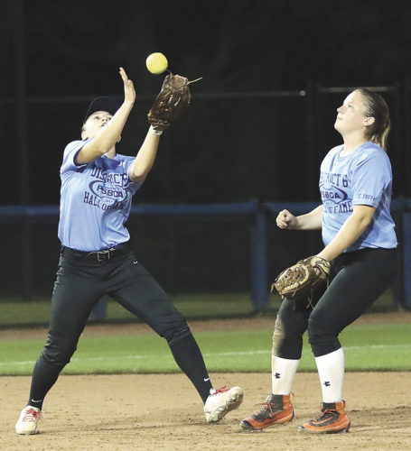 Sentinel photo by MATTHEWSTRICKER  Mifflin County's Darcy Wilson, left, grabs a pop-up as District 6 teammate Keyara Morgan looks on in the PSBCA all-star game, Thursday, in University Park.