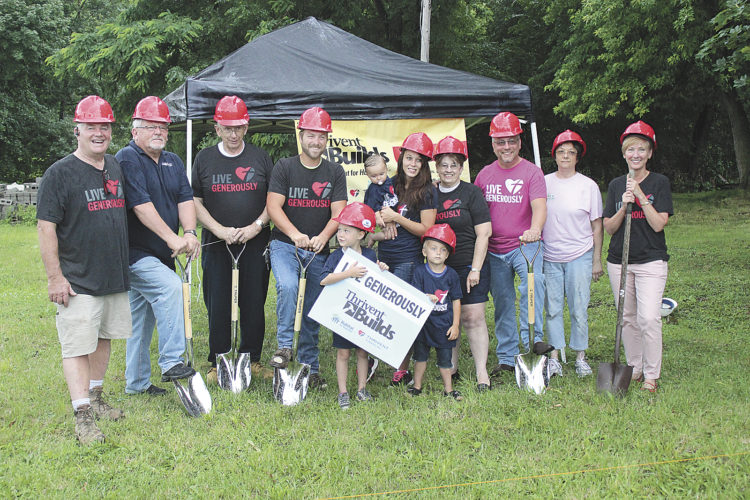 Sentinel photo by JULIANNE CAHILL Habitat for Humanity of Mifflin County breaks ground on its newest building project, located along Lindy Lane in Lewistown. Pictured are, from left, Jeff Bell, president of Habitat for Humanity of Mifflin County; Mike Spahr and Harold Aitkin, volunteers; Randy, Lilianah, Macey holding Reeslyn, and Ryker Dressler, home recipients; Jerry Aitkin, volunteer; Rick Baldwin, of Thrivent; Juanita Henry, Habitat treasurer; and Lori Henry, of Thrivent Financial. Habitat received a grant of $36,000 from Derry Township for the acquisition of the property on which a new home will be built for the Dressler family. A grant from Thrivent Financial will cover half the cost of construction, $55,000. The organization is still looking to raise the remaining cost of $55,000 through community and church donations. To offer monetary donations or volunteer during the build, contact Bell at 348-5161.
