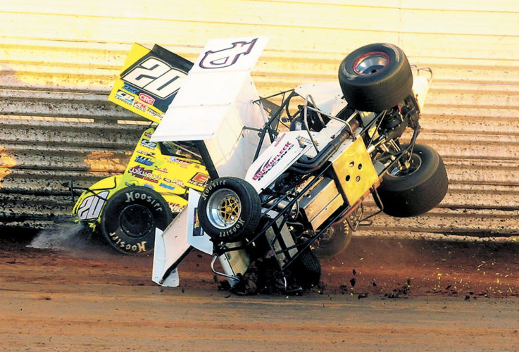 Sentinel photo by TIM SHUMAKER Ryan Taylor (20) spins and collects Jon Brennfleck (4B) during heat race action Saturday at Port Royal Speedway.