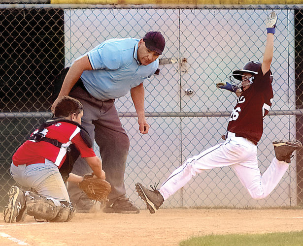 Sentinel photo by MATTHEW STRICKER  Big Valley catcher Truitt Davis prepares to tag out State College base runner Adam Schirf at home Monday in State College. Big Valley won the game, 7-4.