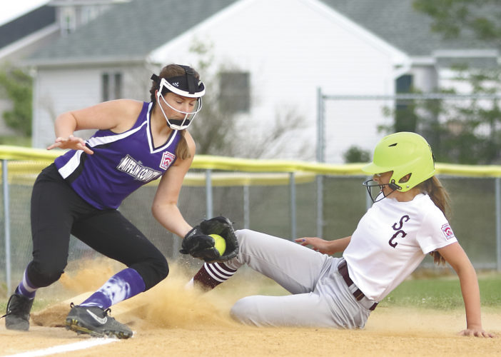 Sentinel photo by MATTHEW STRICKER  Mifflin County third baseman Bailey McNitt applies a tag on State College's Zia Bodnar who's attempting to steal the base during a Little League softball District 5 Major tournament game Tuesday in State College.