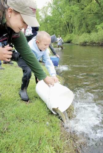 Sentinel file photo  Kendra Swartz, of East Waterford, helps her son Wyatt empty his trout into Lost Creek on May 14 in Oakland Mills as part of Lack-Tuscarora Elementary School's annual trout release. A program was held at Lost Creek Golf Course for the students to teach them about watersheds, local conservation organizations, stream restoration, recycling, fly fishing and an insect study.